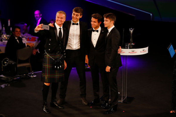 "2017 Autosport Awards Grosvenor House Hotel, Park Lane, London. Sunday 3 December 2017. David Coulthard takes a selfie with ""the future of Formula 1"", George Russell, Lando Norris and Charles Leclerc. World Copyright: Zak Mauger/LAT Images Ref: Digital Image _l5r8114"