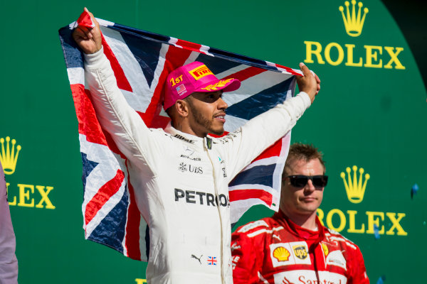 Circuit of the Americas, Austin, Texas, United States of America. Sunday 22 October 2017. Lewis Hamilton, Mercedes AMG, 1st Position, with a Union flag on the podium. World Copyright: Zak Mauger/LAT Images  ref: Digital Image _X0W7172