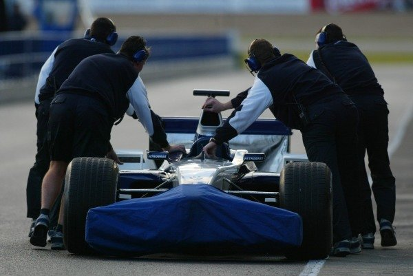 The Williams mechanics recover a broken down car.