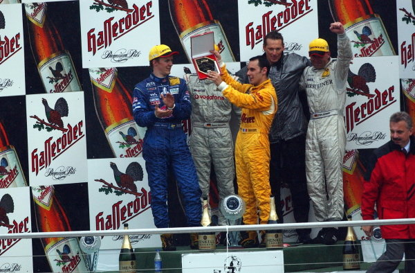 During the last podium ceremony of the 2002 season, Laurent Aiello (FRA), Team Abt Sportsline, is presented with a plague for the 2002 DTM Drivers Championship.DTM Championship, Rd10, Hockenheim, Germany. 06 October 2002.DIGITAL IMAGE