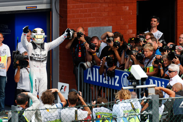 Spa-Francorchamps, Spa, Belgium. Sunday 23 August 2015. Lewis Hamilton, Mercedes AMG, 1st Position, celebrates in Parc Ferme. World Copyright: Alastair Staley/LAT Photographic ref: Digital Image _79P5383