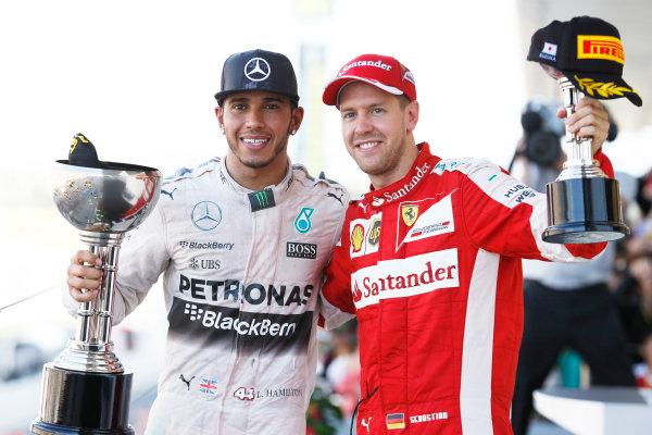 Suzuka Circuit, Suzuka, Japan.  Sunday 27 September 2015. Lewis Hamilton, Mercedes AMG, 1st Position, and Sebastian Vettel, Ferrari, 3rd Position, with their trophies. World Copyright: Steven Tee/LAT Photographic ref: Digital Image _X0W2125