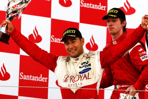 Round 4.Silverstone, England. 11th July 2010. Sunday Race. Daniel Morad, (CAN, Status Grand Prix) celebrates victory on the podium.Portrait. World Copyright: Charles Coates/GP3 Media Service.  Digital Image _26Y4409