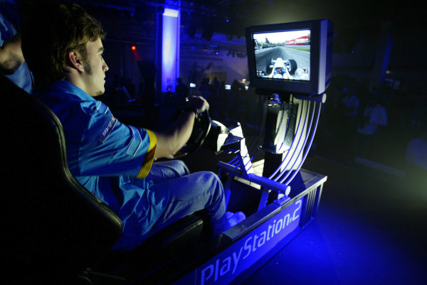 2003 European Grand Prix - Friday 1st Qualifying,Nurburgring, Germany.27thth June 2003.Fernando Alonso, Renault R23 and Jenson Button, B-A-R Honda 005 compete at the Playstation driving game.World Copyright LAT Photographic.Digital Image Only.