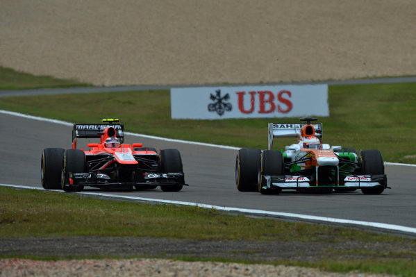 Paul di Resta (GBR) Force India VJM06. and Max Chilton (GBR) Marussia F1 Team MR02.Formula One World Championship, Rd9, German Grand Prix, Practice, Nurburgring, Germany, Friday 5 July 2013.