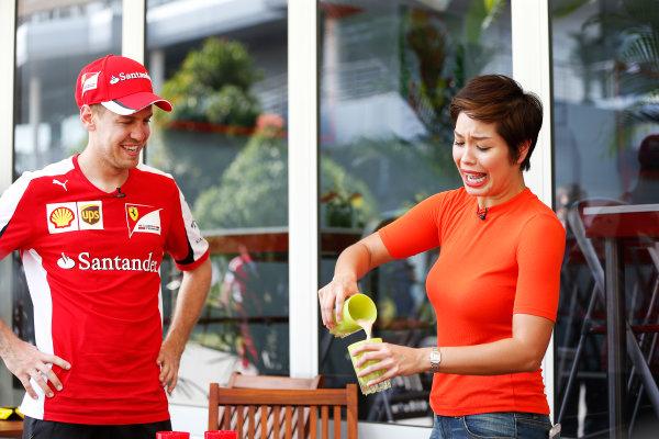 Sepang International Circuit, Sepang, Kuala Lumpur, Malaysia. Thursday 26 March 2015. Sebastian Vettel, Ferrari, in the Paddock. World Copyright: Charles Coates/LAT Photographic. ref: Digital Image _N7T2786
