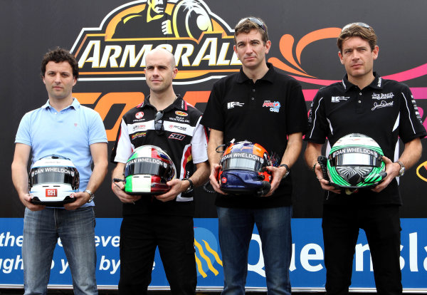 20-23 October, 2011, Surfers Paradise, AustraliaDarren Turner, Marino Franchitti, Oliver Gavin and Richard Westbrook show off the Dan Wheldon Visor strips on their helmets during the Armor All Gold Coast 600, event 11 of the 2011 Australian V8 Supercar Championship Series at the Gold Coast Street Circuit, Gold Coast, Queensland, ©2011, Marshall PruettEDITORIAL USAGE ONLY