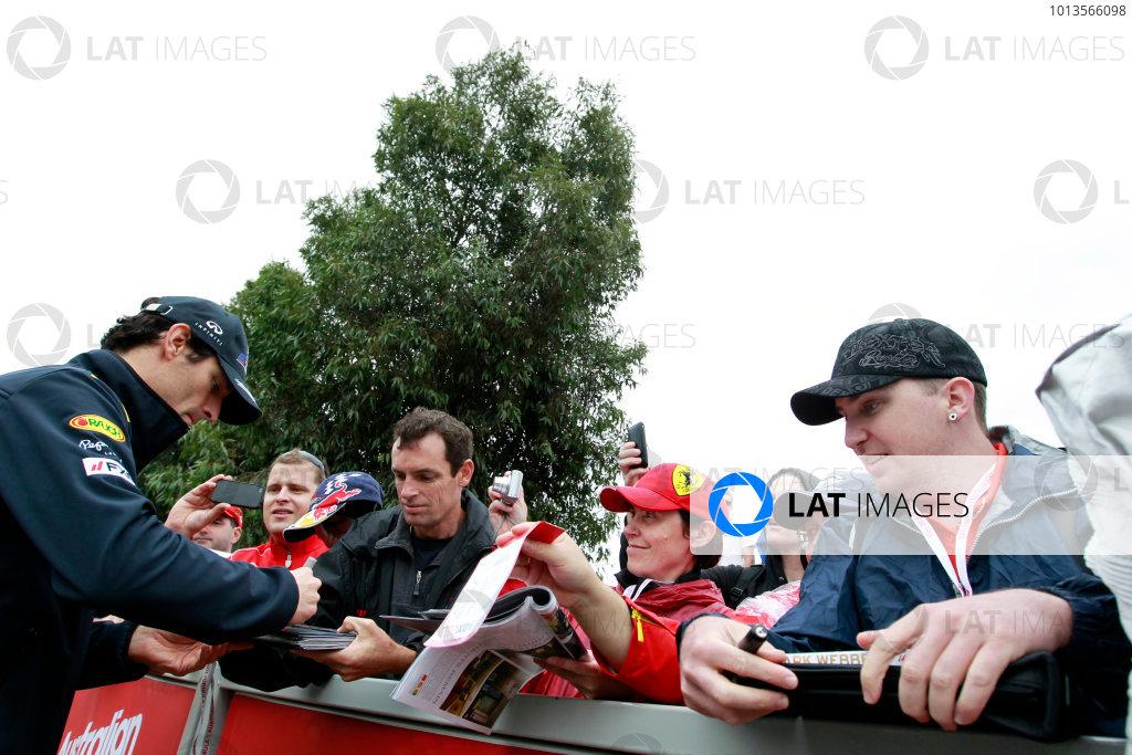 Albert Park, Melbourne, Australia24th March 2011.Mark Webber, Red Bull Racing RB7 Renault. Signs autographs for fans. Portrait. World Copyright: Charles Coates/LAT Photographicref: Digital Image _X5J7089