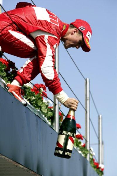 2006 San Marino Grand Prix - Sunday Race Imola, Italy. 20th - 23rd April 2006 Michael Schumacher, Ferrari 248F1, 1st position, podium. World Copyright: Charles Coates/LAT Photographic ref: Digital Image ZK5Y0456