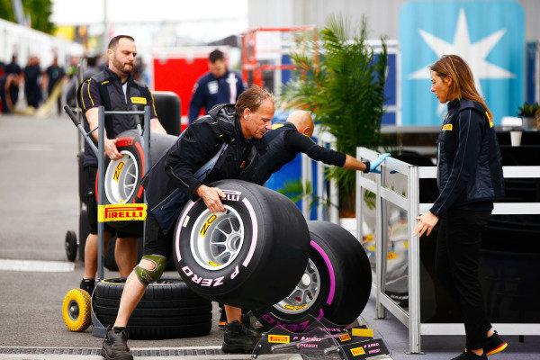 Pirelli personnel unload tyres in the paddock.