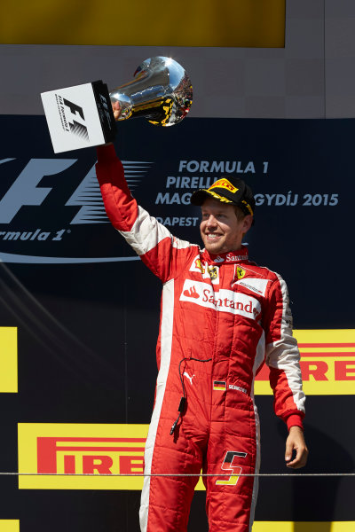 Hungaroring, Budapest, Hungary. Sunday 26 July 2015. Sebastian Vettel, Ferrari, 1st Position, with his trophy on the podium. World Copyright: Steve Etherington/LAT Photographic ref: Digital Image SNE14316