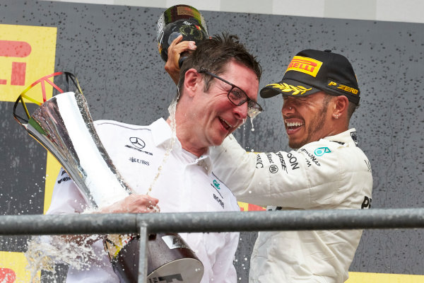 Spa Francorchamps, Belgium.  Sunday 27 August 2017. Lewis Hamilton, Mercedes AMG, 1st Position, pours Champagne over Andrew Shovlin, Chief Race Engineer, Mercedes AMG. World Copyright: Steve Etherington/LAT Images  ref: Digital Image SNE10778