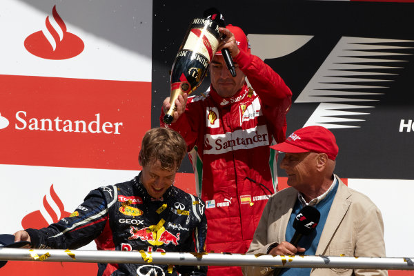 Hockenheimring, Hockenheim, Germany 22nd July 2012 Fernando Alonso, Ferrari, 1st position, and Sebastian Vettel, Red Bull Racing, 2nd position, on the podium with Niki Lauda. World Copyright: Steve Etherington/LAT Photographic ref: Digital Image HC5C5999 copy