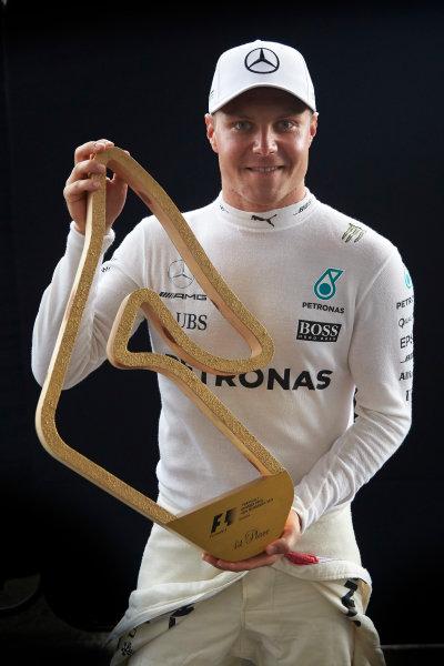 Red Bull Ring, Spielberg, Austria. Sunday 9 July 2017. Valtteri Bottas, Mercedes AMG, 1st Position, with his trophy. World Copyright: Steve Etherington/LAT Images ref: Digital Image SNE19030