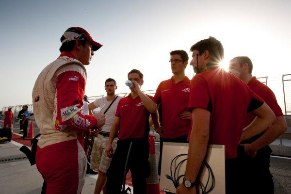 Bahrain International Circuit. Sakhir, Bahrain.Thursday Qualifying. 25th February.Jules Bianchi (FRA, ART Grand Prix) with his team. Portrait. World Copyright: Alastair Staley/GP2 Media Service.Ref: _P9O0443 jpg