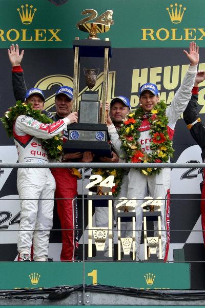 Race winners Tom Kristensen (DEN) / Loic Duval (FRA) / Allan McNish (GBR) Audi Sport Team Joest celebrates on the podium with Dr Wolfgang Ullrich (GER) Audi Sport Team Manager. Le Mans 24 Hours, Le Mans, France, 20-23 June 2013.