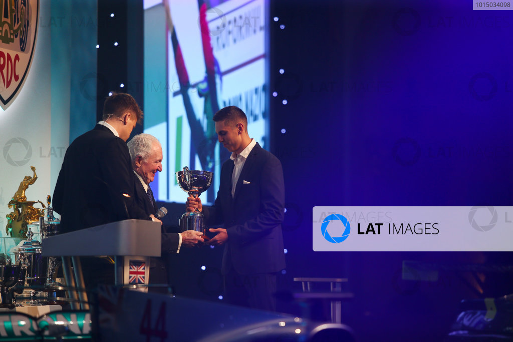 2017 British Racing Drivers Club Awards. London Hilton Hotel, Park Lane, London. Monday 4th December 2017. Paddy Hopkirk presents the Graham Hill Trophy to Harrison Scott. World Copyright: Jakob Ebrey / LAT Images. Ref: Scott-02