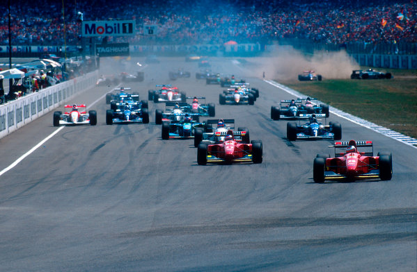 1994 German Grand Prix.Hockenheim, Germany.29-31 July 1994.Gerhard Berger leads teammate Jean Alesi (both Ferrari 412T1B's), Ukyo Katayama (Tyrrell 022 Yamaha), Damon Hill (Williams FW16 Renault) and Michael Schumacher (Benetton B194 Ford) at the start. Behind Alessandro Zanardi (Lotus 109 Mugen-Honda) goes straight into the pit wall after being hit by Andrea de Cesaris. Behind him is Pierluigi Martini (Minardi M194 Ford). On the right is where Andrea de Cesaris (Sauber C13 Mercedes) ends up managing to take out Michele Alboreto in the other Minardi M194 Ford as well.Ref-94 GER 19.World Copyright - LAT Photographic