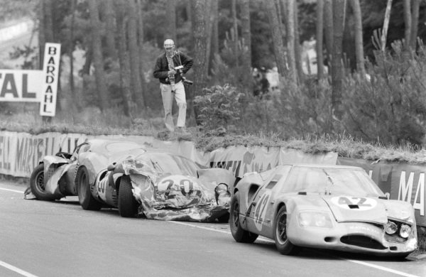 The wreckage of Jo Schlesser /  Alan Rees' Matra Sports SARL, Matra M620 - BRM P56 (#42), Ludovico Scarfiotti / Mike Parkes' SpA Ferrari SEFAC, Ferrari 330 P3 (#20), and Georges Heligouin / Jean Rives' S.E.C. Automobiles C.D., C.D. SP66 - Peugeot 204, by the side of the track.