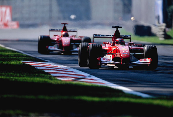 2002 Italian Grand PrixMonza, Italy. 14th - 16th September 2002Rubens Barrichello, Ferrari F2002, leads team mate Michael Schumacher, Ferrari F2002.World Copyright - LAT Photographicref: 35mm Transparency 02_ITA_24