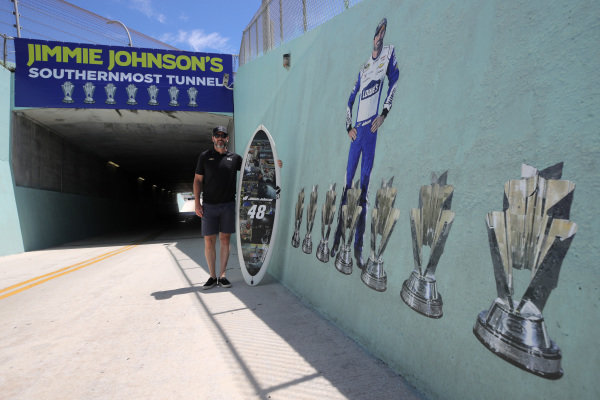 Jimmie Johnson, Hendrick Motorsports Chevrolet Ally, poses for a photo opportunity after having the turn three tunnel named in his honor, Copyright: Chris Graythen/Getty Images.