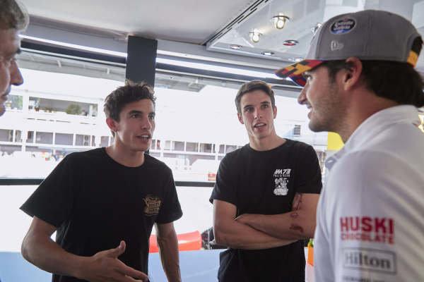 Moto GP riders Alex and Marc Marquez with Carlos Sainz Jr, McLaren