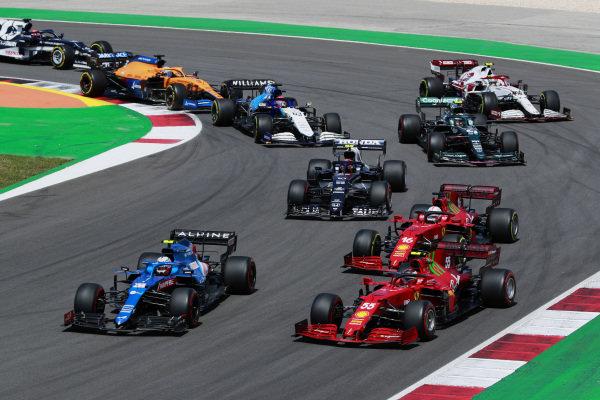 Esteban Ocon, Alpine A521, leads Carlos Sainz, Ferrari SF21, Charles Leclerc, Ferrari SF21, Pierre Gasly, AlphaTauri AT02, Sebastian Vettel, Aston Martin AMR21, Antonio Giovinazzi, Alfa Romeo Racing C41, and George Russell, Williams FW43B