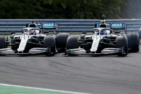Lewis Hamilton, Mercedes AMG F1 W10, battles with Valtteri Bottas, Mercedes AMG W10, at the start