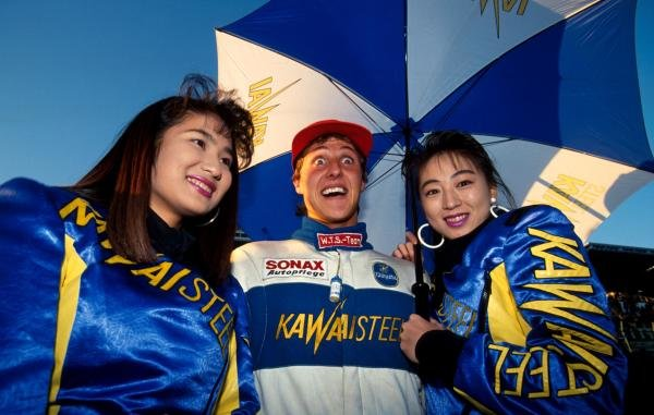 The thought of having two girls at once is all a bit too much for race winner Michael Schumacher (GER).  
