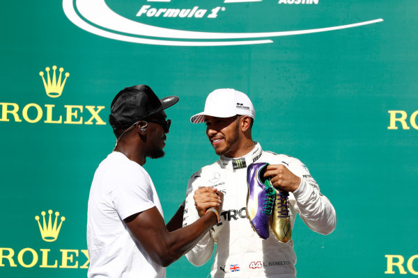 Circuit of the Americas, Austin, Texas, United States of America. Sunday 22 October 2017. Usain Bolt presents Lewis Hamilton, Mercedes AMG, 1st Position, with a pair of his running shoes. World Copyright: Glenn Dunbar/LAT Images  ref: Digital Image _31I5692