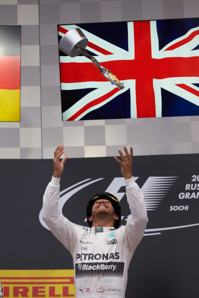 Sochi Autodrom, Sochi, Russia. Sunday 11 October 2015. Lewis Hamilton, Mercedes AMG, 1st Position, tosses his trophy in the air in celebration. World Copyright: Steve Etherington/LAT Photographic ref: Digital Image SNE21711