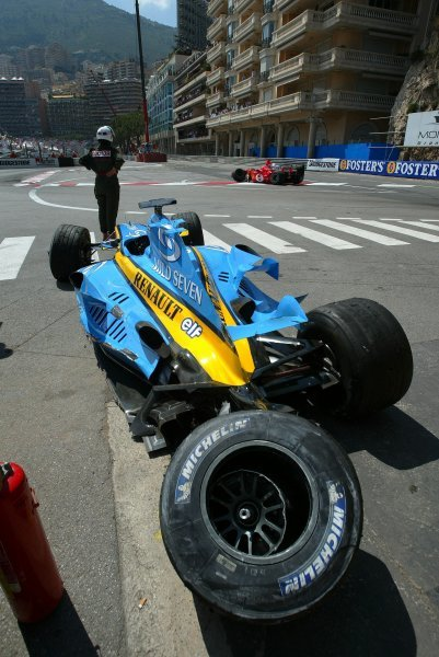The damaged Renault R24 of Fernando Alonso (ESP) after he crashed out of second position is passed by Michael Schumacher (GER) in his damaged Ferrari F2004.Formula One World Championship, Rd 6, Monaco Grand Prix, Race Day, Monte Carlo, 23 May 2004.DIGITAL IMAGEBEST IMAGE