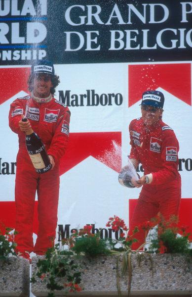 1987 Belgian Grand Prix.Spa-Francorchamps, Belgium.15-17 May 1987.  Alain Prost (McLaren TAG Porsche) 1st position and teammate Stefan Johansson (McLaren TAG Porsche) 2nd position on the podium.  Ref: 87BEL13. World Copyright - LAT Photographic