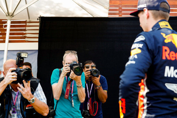 Photographers take pictures of Max Verstappen, Red Bull Racing