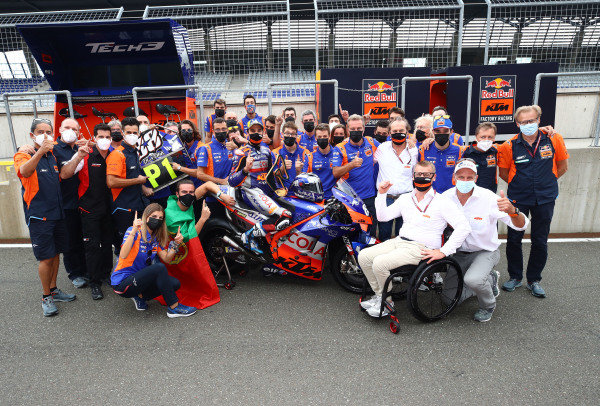Race winner Miguel Oliveira, Red Bull KTM Tech 3 celebrates with teams members.