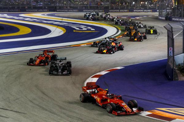 Charles Leclerc, Ferrari SF90 leads Lewis Hamilton, Mercedes AMG F1 W10, Sebastian Vettel, Ferrari SF90,aa and Valtteri Bottas, Mercedes AMG W10 at the start of the race