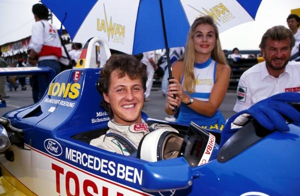 Michael Schumacher (GER) (in car) WTS Motorsport, won leg one but only managed 13th overall, with his manager Willi Weber (GER) (right). 36th Macau Formula Three Grand Prix, Macau, Hong Kong, 26 November 1989
