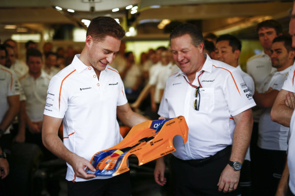 Zak Brown, Executive Director, McLaren Racing presents Stoffel Vandoorne, McLaren with a farewell gift from the team