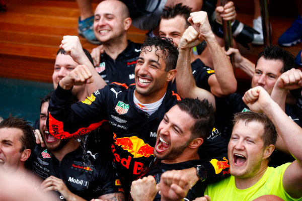 Daniel Ricciardo, Red Bull Racing, celebrates victory in the swimming pool on the Red Bull Energy Station with team members.