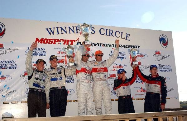 Overall podium and results:1st: Marco Werner (GER) / Frank Biela (GER) Joest Racing, centre.2nd: Andy Wallace (GBR) / Chris Dyson (USA) Dyson Racing, left.3rd: Scott Maxwell (USA) / Gunnar Jeannette (USA) JML Panoz.American Le Mans Series, Mosport, Canada, 17 August 2003.DIGITAL IMAGE.