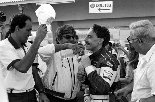 Race winner Andy Wallace (GBR), Madgwick Motorsport Reynard 863-Volkswagen, second from right, is congratulated by his team.Macau Formula 3 Grand Prix, Macau, Hong Kong, November 1986.