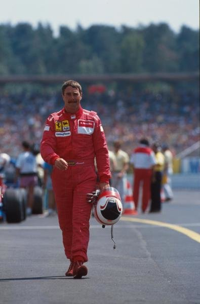 Nigel Mansell walks back to the pits after retiring