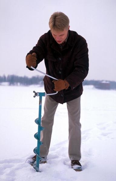 Mika Salo (FIN) drills a hole in the snow.Formula One Drivers At Home, Helsinki, Finland, 1995.
