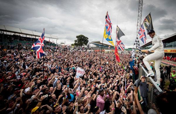 Silverstone, Northamptonshire, UK.  Sunday 16 July 2017. Lewis Hamilton, Mercedes AMG, 1st Position, celebrates victory with the British fans. World Copyright: Dunbar/LAT Images  ref: Digital Image _X4I8649