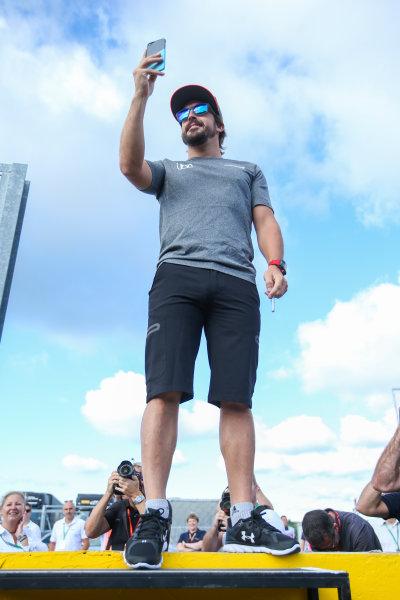 Hungaroring, Budapest, Hungary.  Thursday 27 July 2017. Fernando Alonso, McLaren, takes a photo. World Copyright: Coates/LAT Images  ref: Digital Image AN7T5660