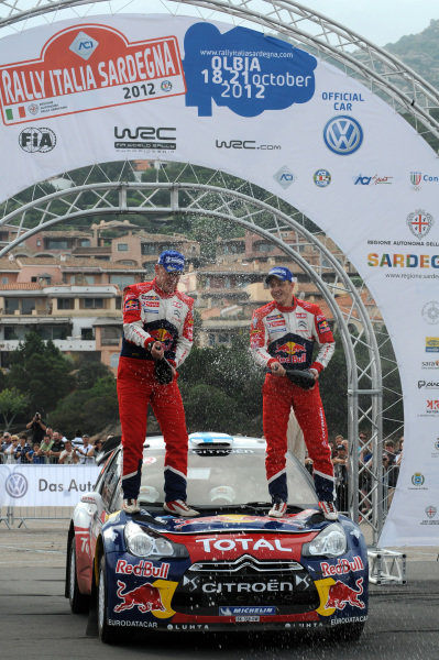 Mikko Hirvonen (FIN) and Jarmo Lehtinen (FIN), Citroen DS3 WRC, celebrate victory on the podium. FIA World Rally Championship, Rd12, Rallye Italia Sardinia, Porto Cervo, Sardinia, Italy, Day Three, Sunday 21 October 2012.