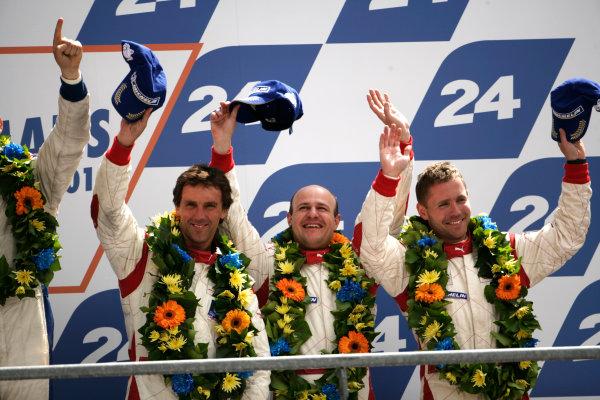 Circuit de La Sarthe, Le Mans, France. 6th - 13th June 2010.Christoffer Nygaard / Tomas Enge / Peter Kox, Young Driver AMR, No 52 Aston Martin DBR9 celebrate on the podium. Portrait. World Copyright: Drew Gibson/LAT PhotographicDigital Image _Y2Z3448