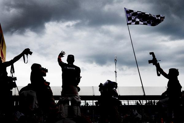 Silverstone Circuit, Northamptonshire, England. Sunday 5 July 2015. Lewis Hamilton, Mercedes AMG celebrates with the fans after the race. World Copyright: Steve Etherington/LAT Photographic ref: Digital Image SNE23305