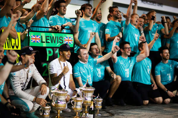 Bahrain International Circuit, Sakhir, Bahrain. Sunday 19 April 2015. Lewis Hamilton, Mercedes AMG, 1st Position, Nico Rosberg, Mercedes AMG, 3rd Position, and the Mercedes team celebrate victory. World Copyright: Alastair Staley/LAT Photographic. ref: Digital Image _R6T1259