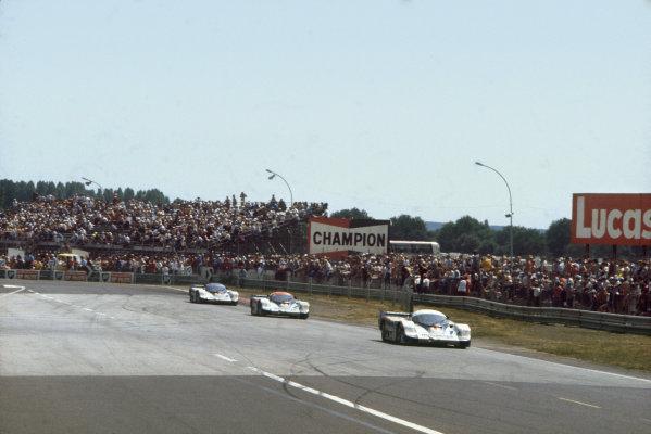 1982 Le Mans 24 hours. Le Mans, France. 19th - 20th June 1982. Jacky Ickx/Derek Bell (Porsche 956), 1st position, leads Jochen Mass/Vern Schuppan (Porsche 956), 2nd position and Hurley Haywood/Al Holbert/Jurgen Barth (Porsche 956), 3rd position, across the line, action.  World Copyright: LAT Photographic. Ref: 82LM03.